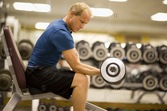 A man weightlifting in a gym