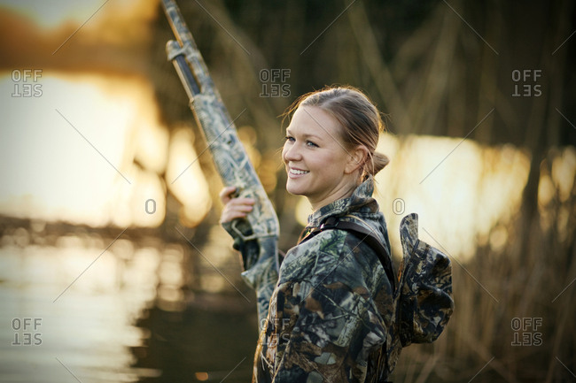 A young woman hunting in a marsh