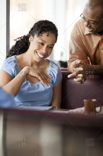 A couple talking and laughing in a cafe