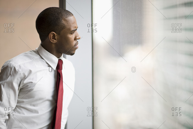 A businessman looking out the window