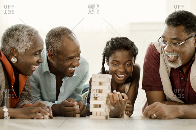 A family playing a block stacking game together
