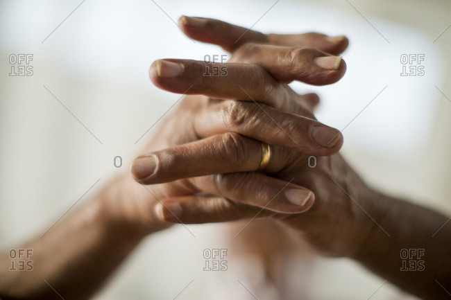 A woman's clasped hands
