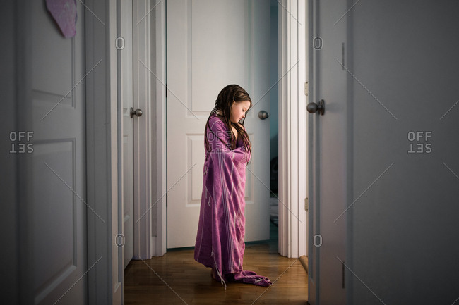 Girl wrapped up inside hallway
