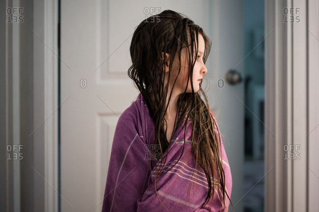 Girl wrapped in cloth with wet hair