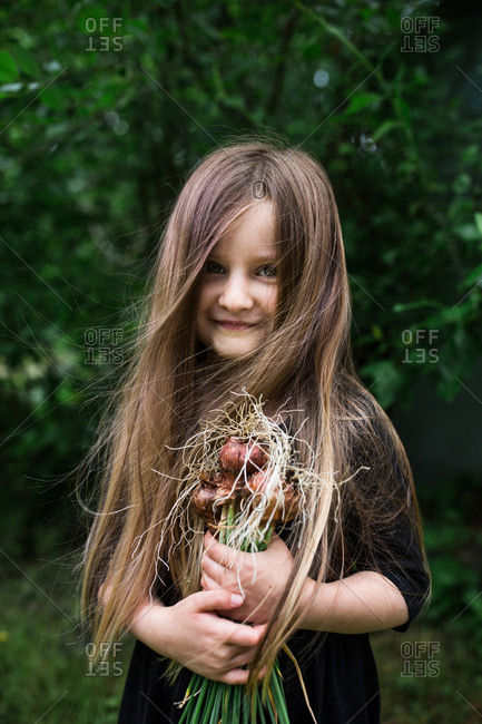 Girl with fresh picked onions