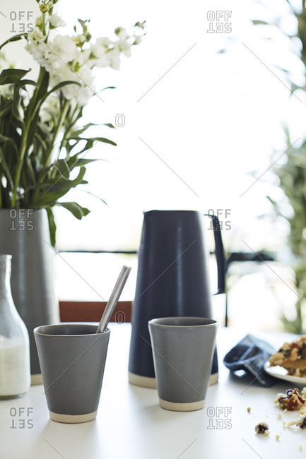 Cups and plants on table
