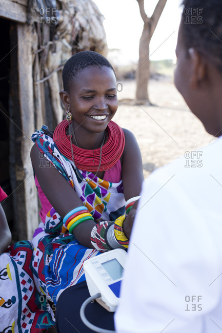 Nurse examining woman in Samburu village in Kenya, Africa