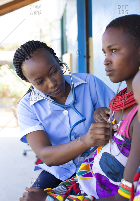 Nurse examining a woman in a clinic in Kenya, Africa