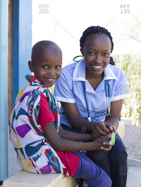 Portrait of a nurse and young girl in clinic in Kenya, Africa