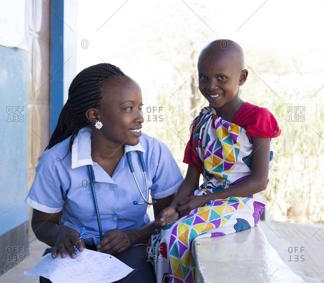 Nurse with a young girl in clinic in Kenya, Africa