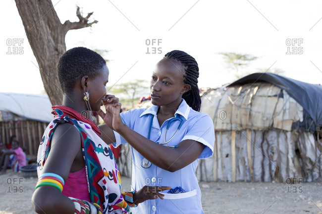 Kenya, Africa - April 25, 2017: Nurse examining patient in rural village location