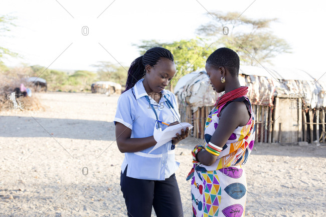 Nurse examining patients in rural village in Kenya, Africa