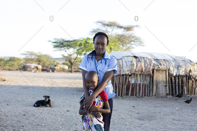 Portrait of nurse and young girl in rural village location in Kenya, Africa