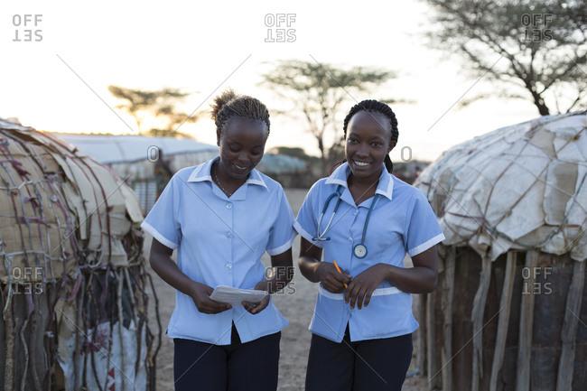 Two nurses working on location in rural village in Kenya, Africa