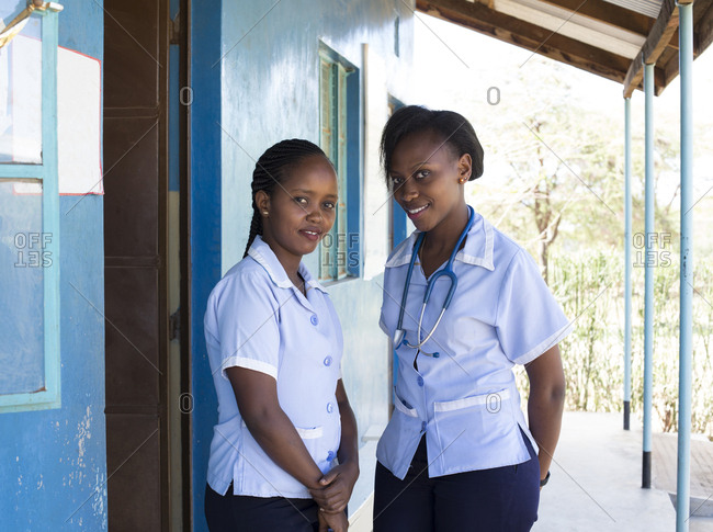 Portrait of two smiling nurses in Kenya, Africa