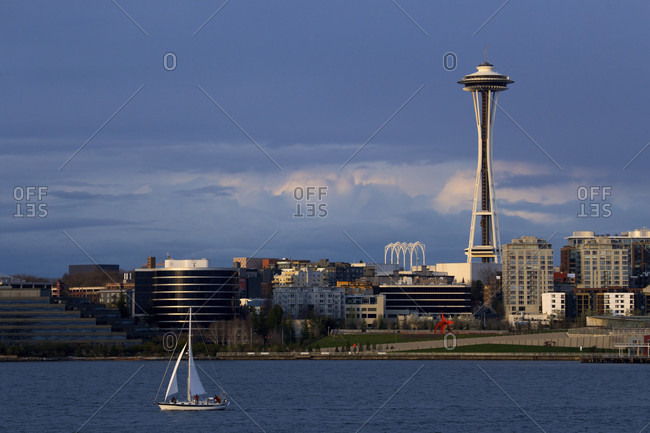 Seattle, Washington, USA - March 30, 2014: Sailboat sailing near the waterfront with Space Needle visible