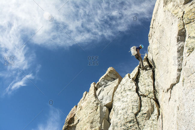 A man rappelling a granite ridge on the Evolution Traverse, John Muir Wilderness, Kings Canyon National Park, Bishop, California