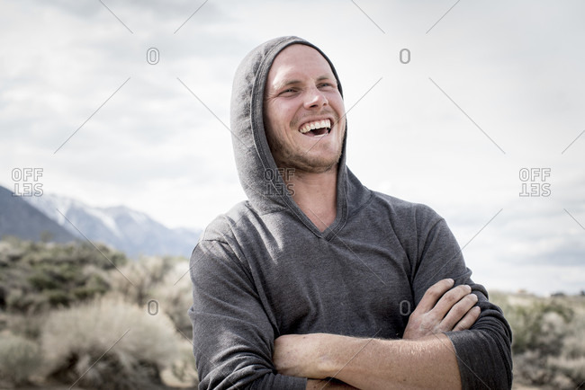 Candid portrait of laughing young climber