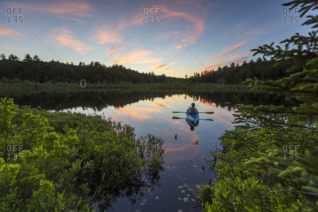 Kayaking On Small Pond At Sunset In Barrington, New Hampshire