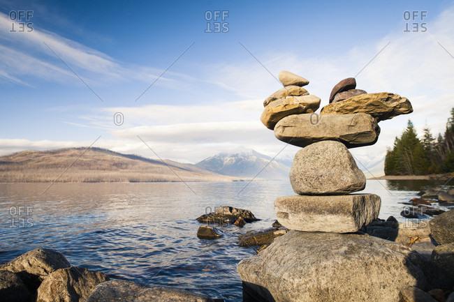 Rocks balance on the shore of Lake McDonald, Glacier National Park