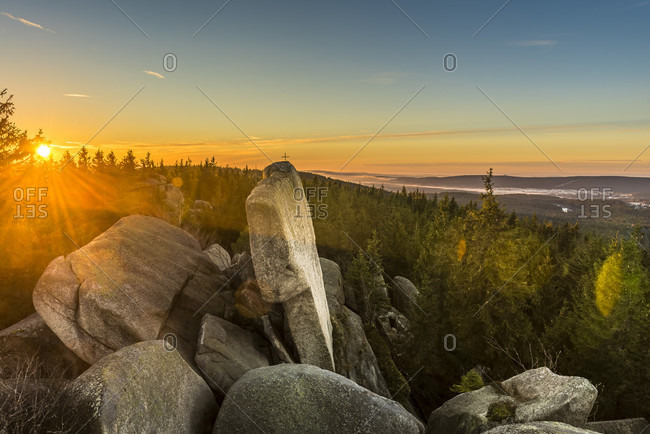 The sun rises above the scenic Nusshardt mountain in the Fichtelgebirge Mountains in Upper Franconia, Bavaria, Germany.