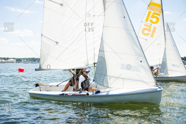 Teenagers sailing in Rhode Island