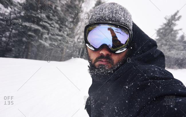 POV portrait of a snowboarder riding down the trail
