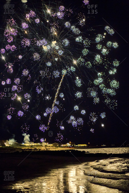 Fireworks explode over the ocean on Cape Cod, MA