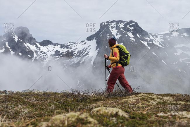 Hiker watching mountain range while walking