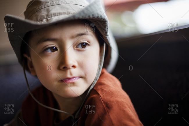 Portrait of contemplative boy wearing cowboy hat