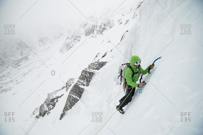 Ice climber leading up into Open Book in Tuckerman Ravine on mount Washington