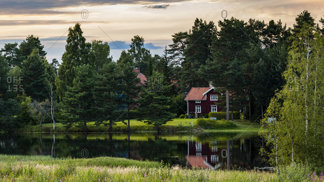 Typical Swedish house surrounded by trees, Mora, Dalarna, Sweden
