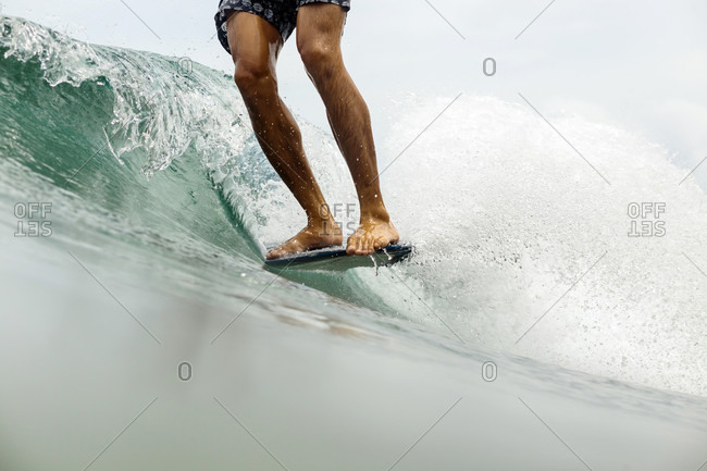 Low section view of surfing man