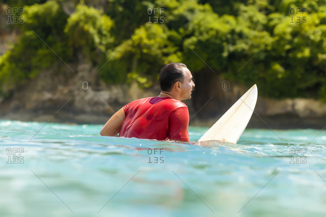 Surfer in water awaiting wave