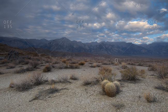 Cloudscape over mountain range and desert