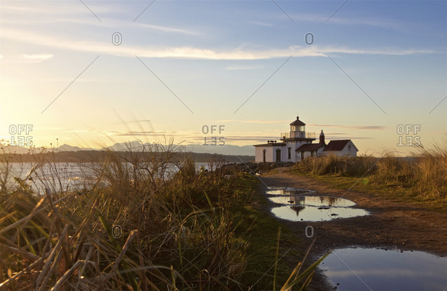 Discovery Park Lighthouse at sunset, Seattle, Washington State, United States