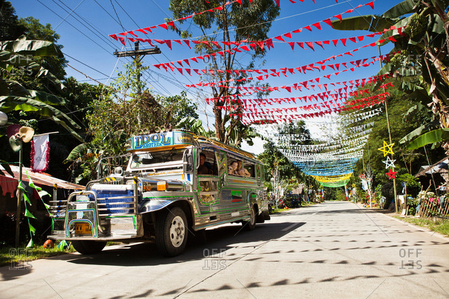 Colorful flags on tropical road