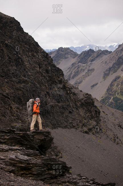 Hiker walking in rocky hills