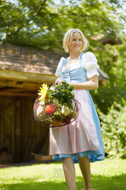 Woman with basket of fresh vegetables