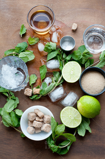 Herbs, lime, sugar and ice cubes