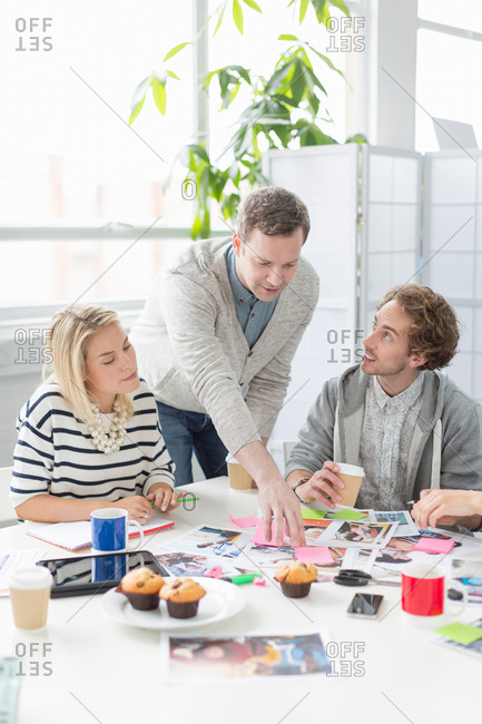 Creative team discussing plans in office meeting