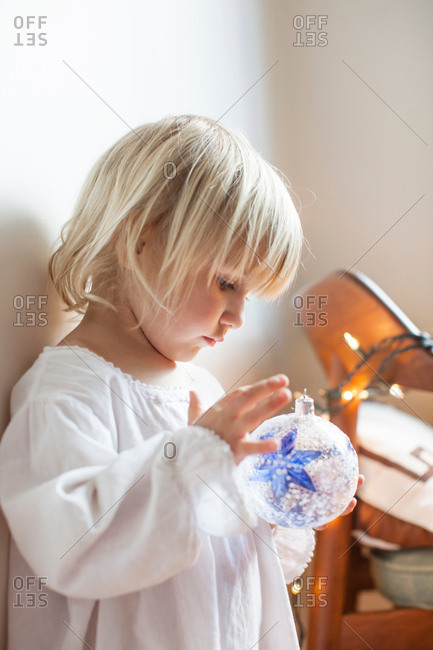 Girl fascinated with blue star bauble