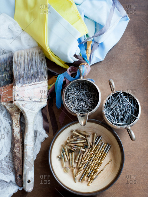 Still life of decorating brushes, textiles and nails