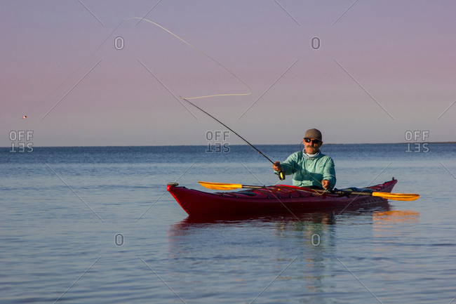 Man fly fishing from kayak in the Florida Everglades, USA