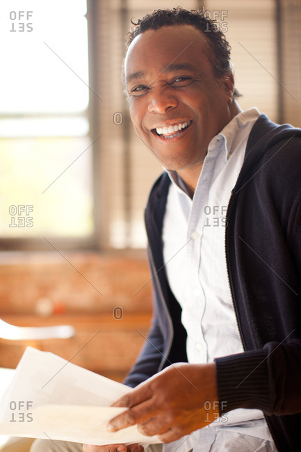 Man posing with charismatic smile and look of happiness