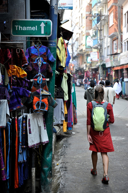 Woman tourist walks down the street of Thamel in Kathmandu, Nepal
