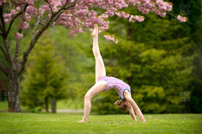 Gymnast performing in park