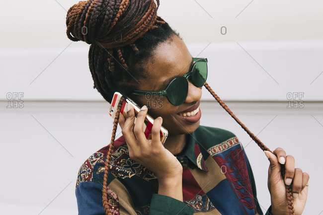 Happy african american woman on the phone
