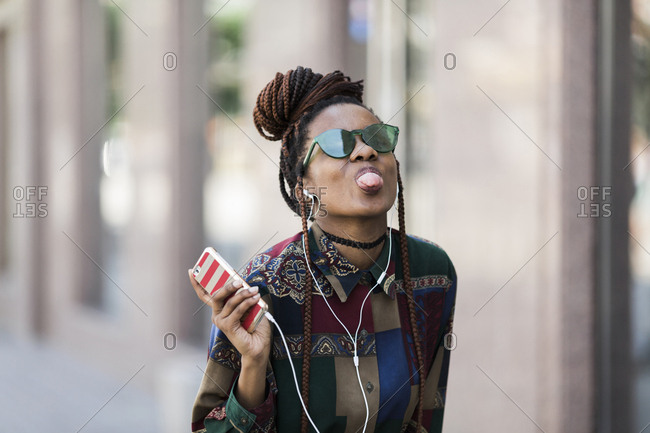 Happy young african american woman on the street