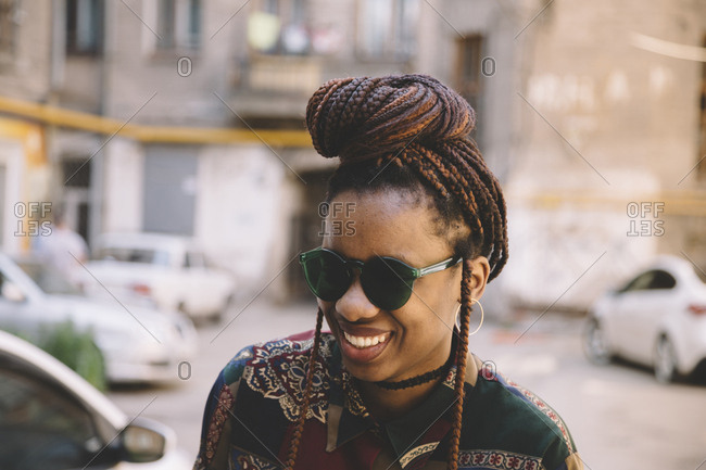 Happy african american woman with green sunglasses